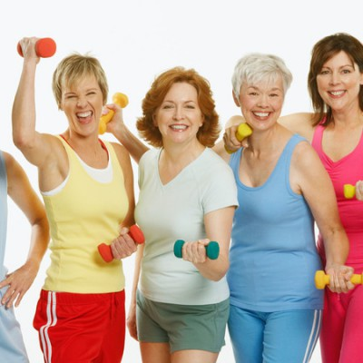 A3EMGM Portrait of a group of mature women holding dumbbells and smiling